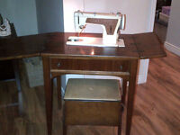 Singer sewing machine in solid wood cabinet