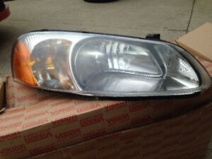 Front headlights off a 2003 Chrysler Sebring.
