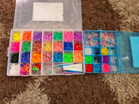 Large collection of unused loom bands and accessories in reusable tubs