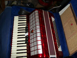 #greenspotantiques red accordian, good condition, with case