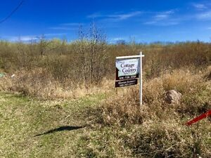 Double lot package with a lake view in Sask Beach!