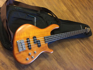 Brand new Cort electric bass guitatr with case and strap
