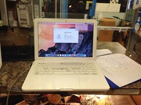 Apple MacBook white - battery faulty. Keyboard a damaged and no charger