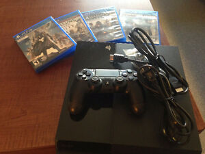 PS4 Game Console and 4 Games - Like NEW**