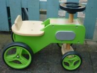 Ride on wooden toy tractor - green. In excellent condition
