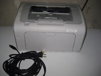 HP LaserJet P1005 with cables and partially used cartridge