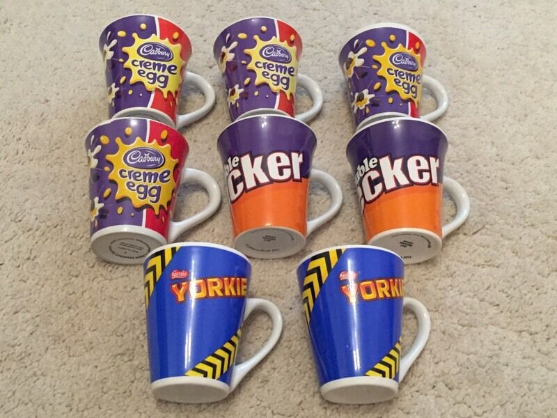 Set of eight coffee mugs all new and unused.