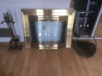Brass fireplace screen with tools and log carrier