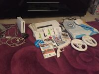 Nintendo Wii with wii fit and several games