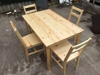 Brand new pine table and chairs