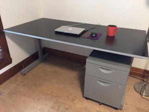 solid desk (31 1/2 * 63 inches) with a metal file cabinet