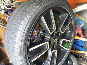 p225/45r18 91v kia rims and tires all season