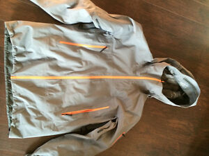 Arcteryx Jacket, Grey with orange zippers.