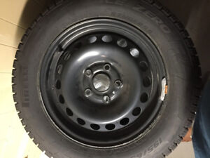 "Practically brand new 15"" Pirelli winter tires on steel rims"