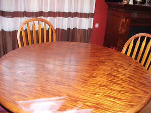 Table with three chairs.
