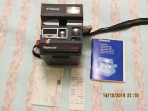 Polaroid 635 CL  with Original bill of sale from HONEST ED,S