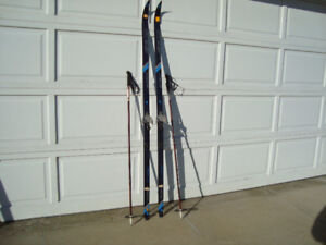 3 sets of Cross country skis, boots and poles