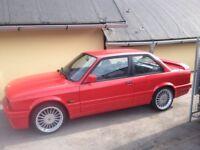 Bmw e30 325i sport Alpina alloys like new.