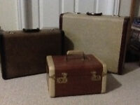 2 vintage suitcases and 1 make up case.