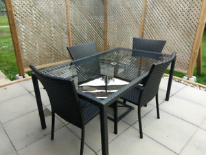 Glass and wicker resin patio set