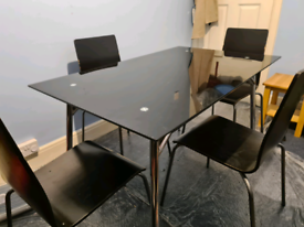 Black glass table and 4 chairs