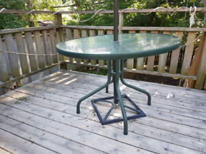 Free round glass top patio table (centre umbrella not included)
