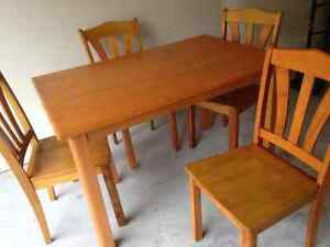 Solid wood dinning table with 4 chairs for sale