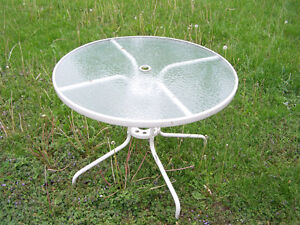 Glass topped round patio table