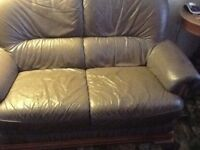 Three piece suite two seater sofa