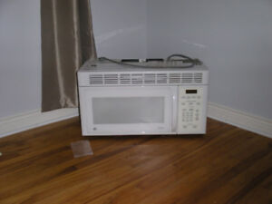 Over the stove GE microwave with fan