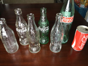 Coca Cola bottles and vintage can