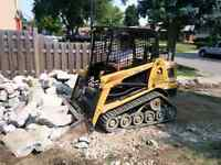 Bobcat and dump truck work