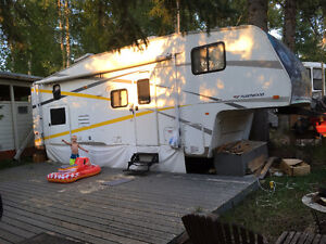 27ft Trailer on Emma Lake Lot (child not included)