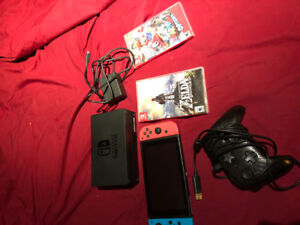 $450. Nintendo Switch w/ 2 Games, Wired Pro Controller