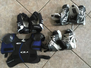 Hockey skates, gloves and chest protector