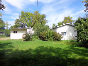 mobile home with two additions on large lot in Donalda AB