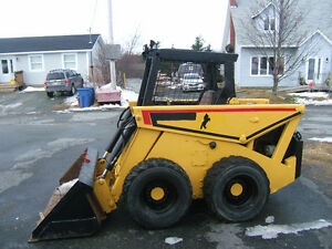 SKID STEER WITH A 4 CYL YANMAR DIESEL RUNNING GOOD((REDUCED))