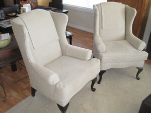Two Matching Wing-back Chairs and Ottoman