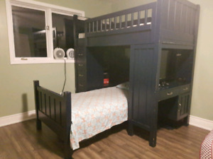 Bunk bed with mattress and ladder