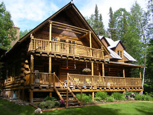 wterfront property with log home
