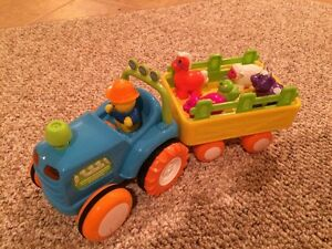 Toy farmer and tractor with animals