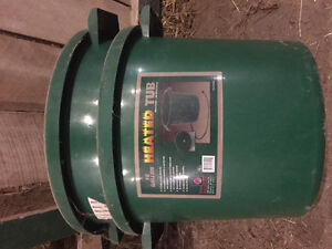Heated 16 gallon livestock water buckets and steel water tank