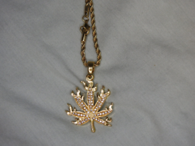 9ct Gold plated flaming leaf pendant with CZ stones