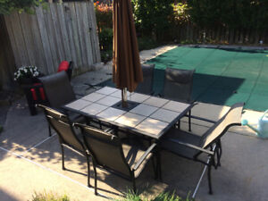 Patio table complete with 6 chairs and umbrella-excellent shape