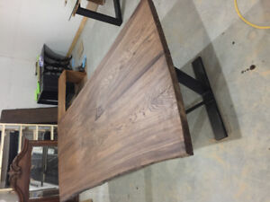 Large, solid live edge wood dining table