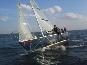 Kirby 25 racing sailboat with trailer and LS outboard