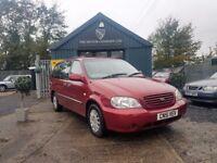 Kia Sedona 2.5 V6 LX (red) 2001