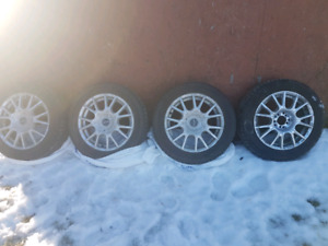 3 studded winter tires and 4 rims