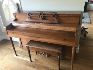 Piano with seat