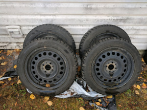 Set of 4 studded winter tires.